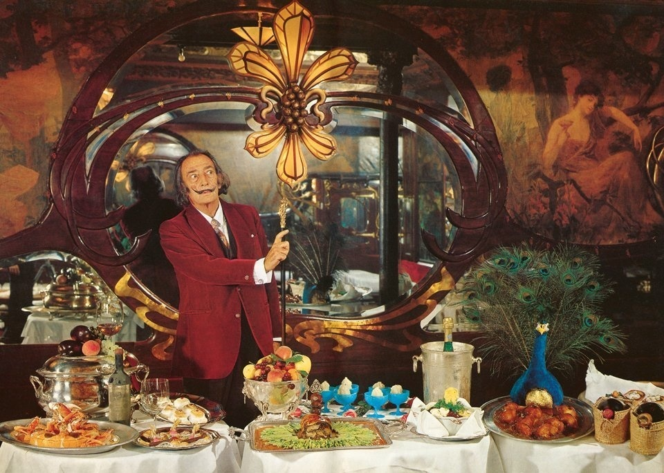 Salvador Dalí's dinner parties were legendary for their opulence and bizarre fare. In 1973, Dalí immortalized these freakish feasts in the book <em>Les Diners de Gala.</em>