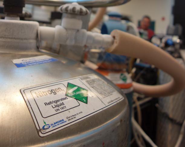 South Coast Air Quality Management District spokesman Sam Atwood observes vapor rising from a machine used to identify organic compounds in air samples.