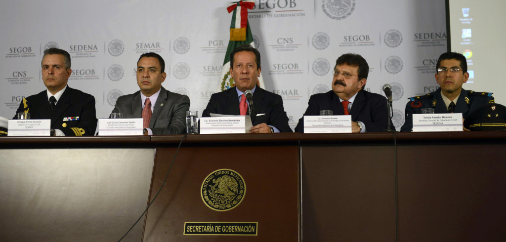 Mexican Navy captain, Enrique Ponce de Leon, the director of press and media of the National Commission of Security, Carlos Cervantes, the Under-Secretary of Media for the Interior Ministry, Eduardo Sanchez, the Under-Attorney for Organized Crime, Cleominio Soreda, and Mexican Army Lieutenant Colonel, Tomas Amador, attend a press conference on the capture of Ines Coronel Barreras, father-in-law of drug trafficker Chapo Guzman and alleged member of the Cartel of Sinaloa, in Mexico City, on April 30, 2013.