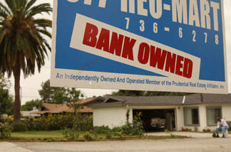 File photo: A realtor sign advertises a bank-owned house for sale June 15, 2009 in Pasadena.