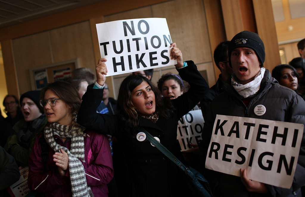 Occupy UC Davis protestors carry signs during the take over of Dutton Hall as demonstrators hold a general strike at the UC Davis campus on November 28, 2011 in Davis, California.