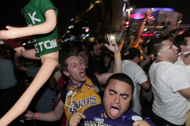 Los Angeles Laker fans celebrate on the street outside the Staples Center after a Lakers win in the NBA final game in downtown Los Angeles on Thursday June 17,2010. Crowds of rowdy revelers poured into the streets around Staples Center after Game 7 of the NBA finals rocking cars, setting bonfires and throwing rocks and bottles at officers.