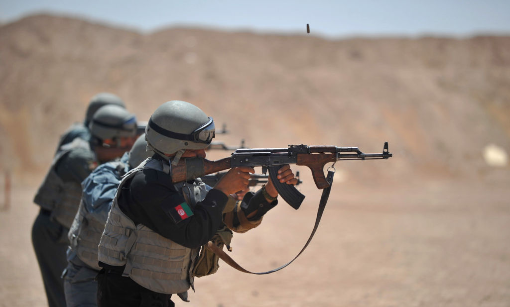 Members of the Afghanistan National Policemen fire their AK-47 rifles during a shooting course taught by US Marines at Camp Leatherneck in Helmand Province on June 19, 2012.