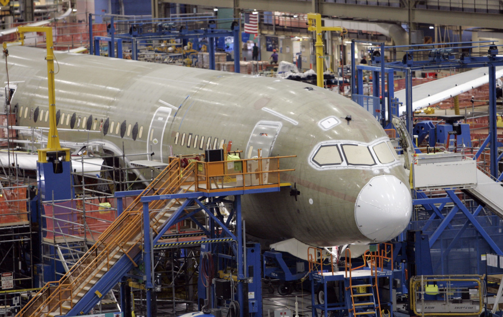 One of the first Boeing 787 jets is seen on the assembly line nearly surrounded by scaffolding during a media tour May 19, 2008, in Everett, Wash. On Tuesday, the Commerce Department reported a 4.3 percent drop in orders for durable goods, led by a big 17.5 percent drop in the volatile category of commercial aircraft.