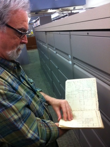 Glen Creason reads a map