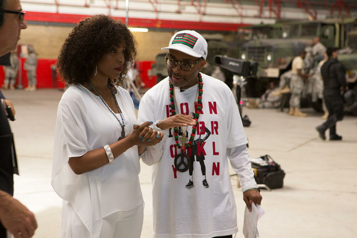 Director Spike Lee speaks with actress Angela Bassett on the set of