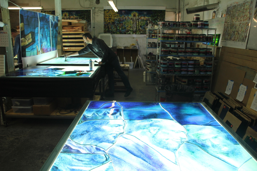 In the basement of the Judson Studios, artist Tim Carey is using the fusing technique.
