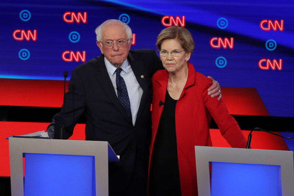 DETROIT, MICHIGAN - JULY 30: Democratic presidential candidate Sen. Bernie Sanders (I-VT) (L) and Sen. Elizabeth Warren (D-MA) embrace after the Democratic Presidential Debate at the Fox Theatre July 30, 2019 in Detroit, Michigan. 20 Democratic presidential candidates were split into two groups of 10 to take part in the debate sponsored by CNN held over two nights at Detroit's Fox Theatre.  (Photo by Justin Sullivan/Getty Images)
