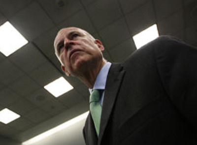 California Attorney General and gubernatorial candidate Jerry Brown arrives to a press conference to announce that he is filing a motion to compel bond-rating firm Moody's Investors Service to comply with a subpoena it has resisted for seven motions on April 19, 2010 in Los Angeles.