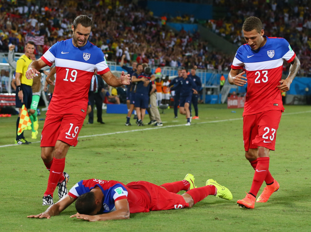 John Brooks of the United States (C) celebrates scoring his team's second goal with Graham Zusi (L) and Fabian Johnson (R) during the 2014 FIFA World Cup Brazil Group G match between Ghana and the United States at Estadio das Dunas on June 16, 2014 in Natal, Brazil.