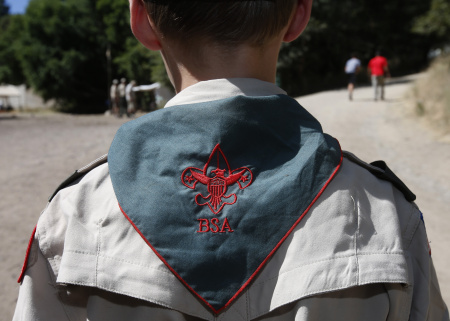 Boy Scout listens to instruction at camp Maple Dell on July 31, 2015 outside Payson, Utah.