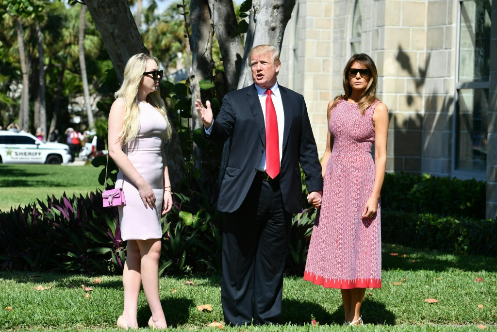 U.S. President Donald Trump, First Lady Melania Trump and daughter Tiffany Trump arrive for Easter services at the Church of Bethesda-by-the-Sea in Palm Beach, Florida, April 1, 2018.