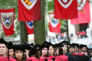 Graduating Harvard University students attend commencement ceremonies in Cambridge, Massachusetts. Elite colleges like Harvard have steadily increased their efforts to admit low-income students in recent years.