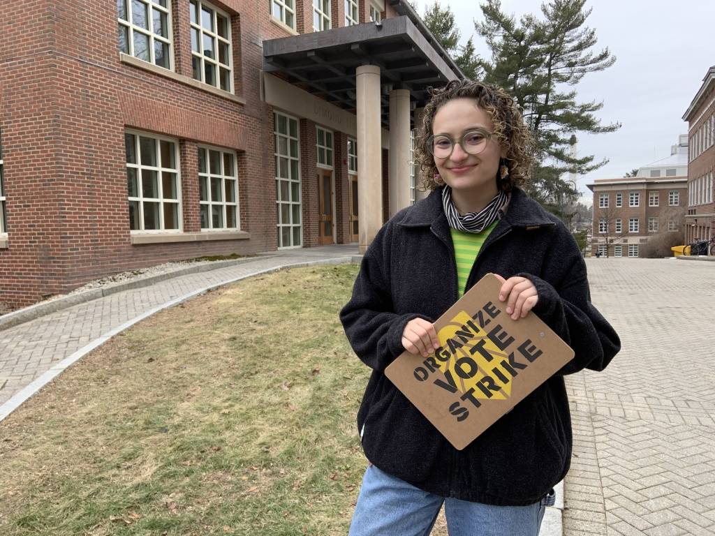 Olivia Freiwald, 20, of the New Hampshire Youth Movement and Sunrise Movement on the main campus of the University of New Hampshire. She's campaigning for Bernie Sanders, in part, because he pledges to ban fracking.