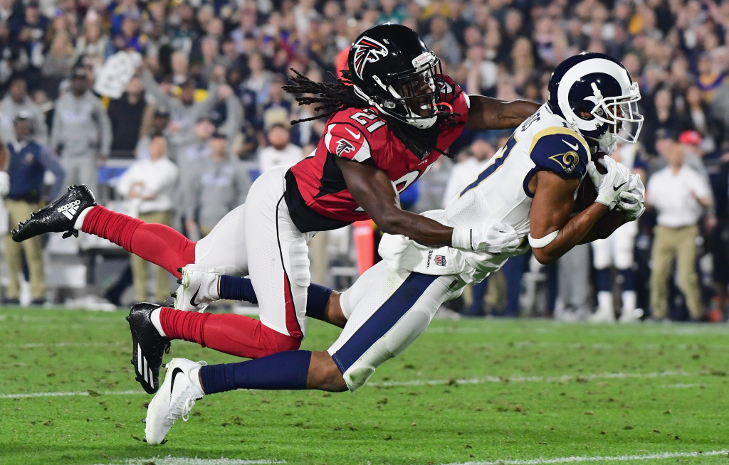 LOS ANGELES, CA - JANUARY 06:  Wide receiver Robert Woods #17 of the Los Angeles Rams makes a catch in front of cornerback Desmond Trufant #21 of the Atlanta Falcons during the second quarter of the NFC Wild Card Playoff game at Los Angeles Coliseum on January 6, 2018 in Los Angeles, California.  (Photo by Harry How/Getty Images)