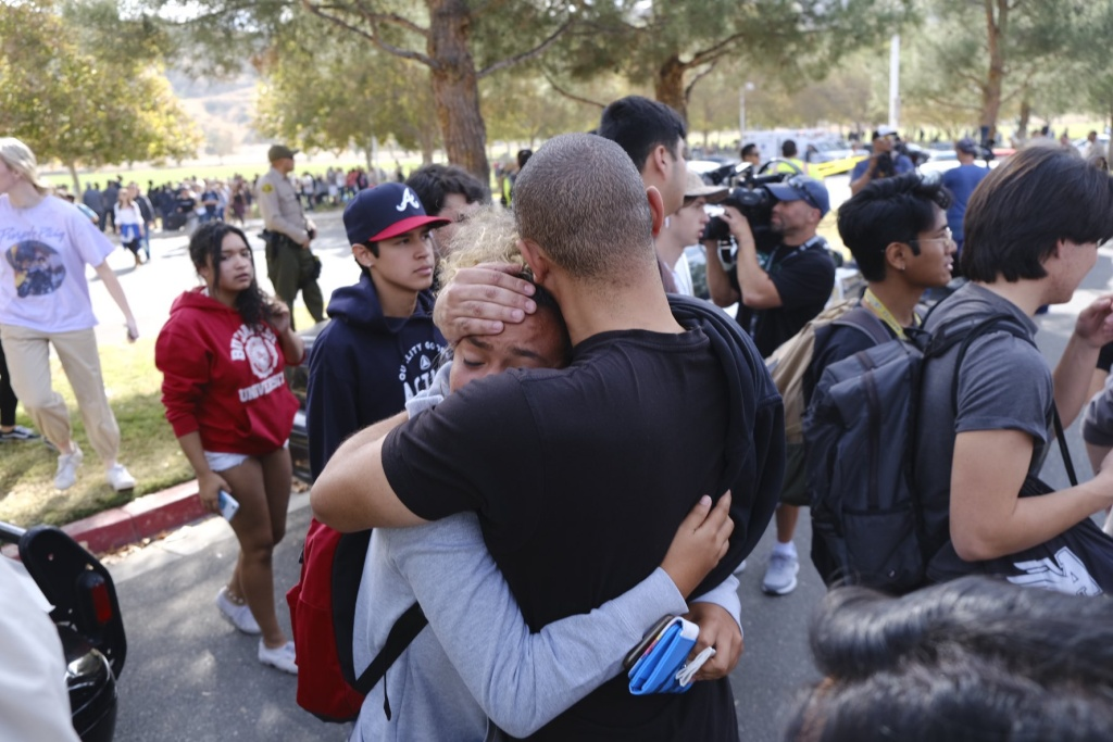 Students reunite with their parents in Santa Clarita's Central Park after a shooting at Saugus High School on the morning of Thursday, Nov. 14, 2019.