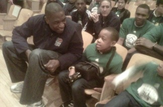 Former NBA All-Star center Dikembe Mutombo visits with Virgil Middle School near Downtown Los Angeles.