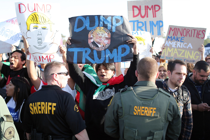 Protestors, Trump supporters and police gather outside a rally for Donald Trump at the Pacific Amphitheater in Costa Mesa on Thursday night, April 28, 2016.