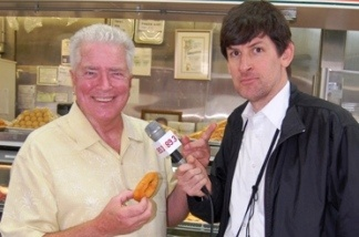 Huell Howser (with donut) and KPCC's John Rabe.