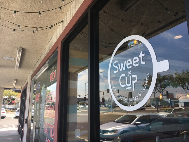 Sweet Cup owner, Kenny Tran holds up a