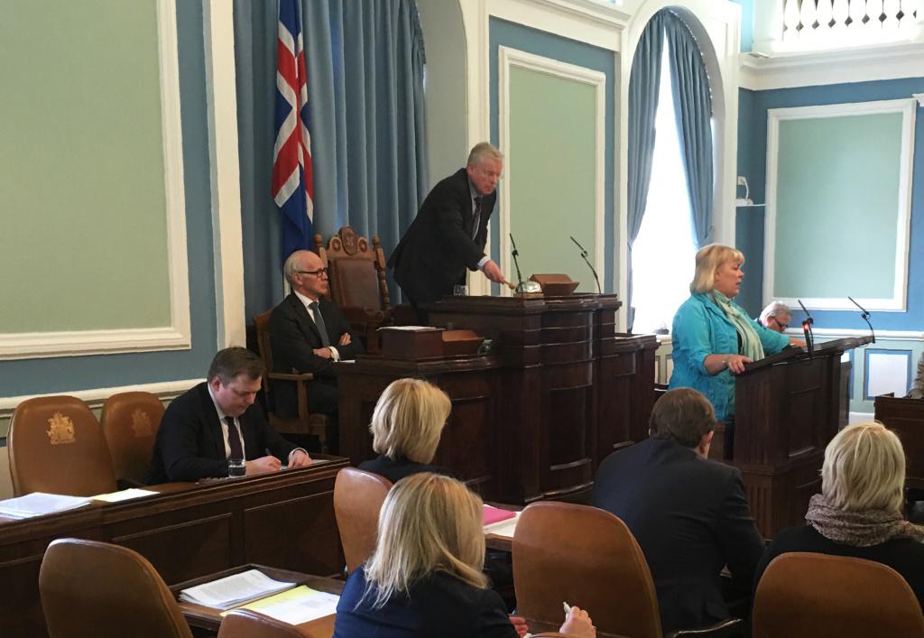Icelands Prime Minister Sigmundur David Gunnlaugsson (L) takes notes. Iceland's prime minister faced calls to resign after leaked