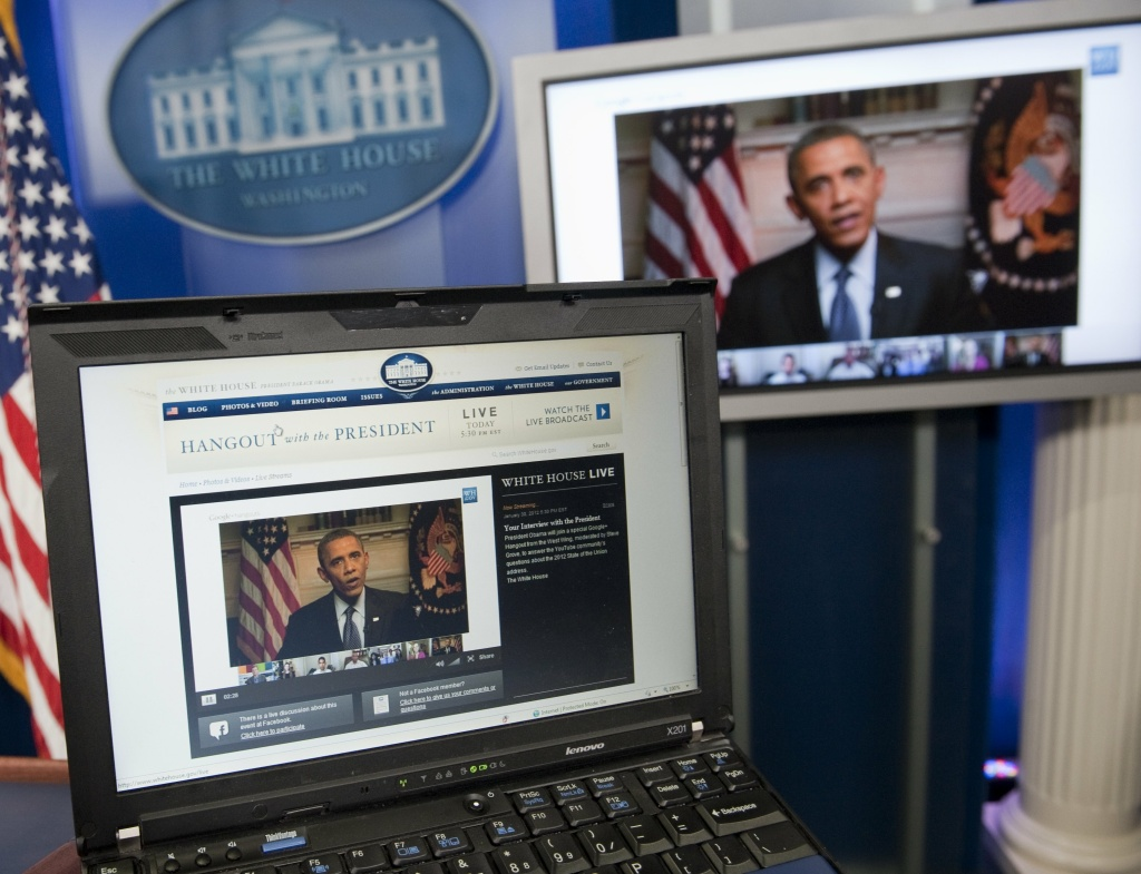 US President Barack Obama participates in an interview with YouTube and Google from the Roosevelt Room of the White House in Washington, DC, as seen on a laptop in the Brady Press Briefing Room.