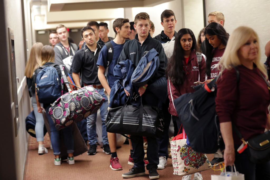 Student survivors from Marjory Stoneman Douglas High School, scene of a deadly mass shooting last Wednesday, prepare to load their bags on busses, after spending the night in the civic center in Tallahassee, Fla., Wednesday, Feb. 21, 2018.