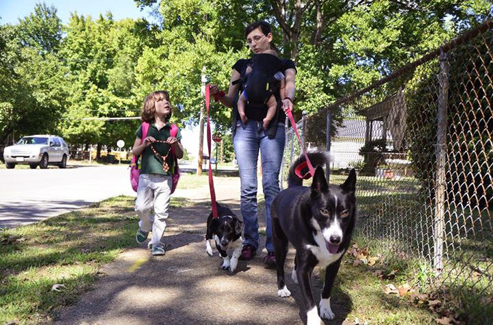 Juniper Russo walks her dogs with her daughter Vivian (left). Russo wants what is best for her daughter, and after three years of soul-searching, she decided vaccination was best.