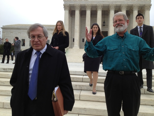 UC Irvine Law School Dean Erwin Chemerinsky (left) and war protester John Apel are backed up by UCI law students who researched arguments for Apel's case before the U.S. Supreme Court