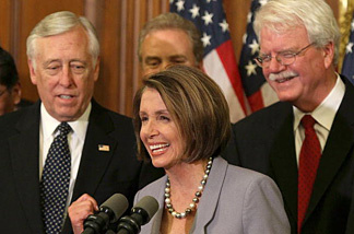 House Speaker Nancy Pelosi (D-CA) speaks at a news conference as House Majority Leader Steny Hoyer (D-MD) (L), and George Miller (D-CA) (R) listen in after the health care vote on Capitol Hill on March 22, 2010 in Washington, DC. The House passed the health care reform legislation that divided Congress with a vote of vote of 219 to 212.