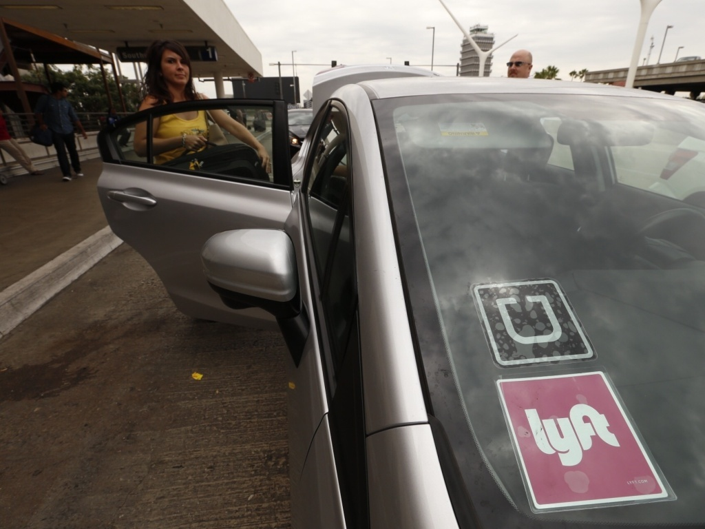In this file photo, a car with Uber and Lyft stickers is seen at Los Angeles International Airport. A bill blocked by a Senate panel Tuesday would have prevented the ride-hailing services from adjusting their prices based on demand, a practice known as