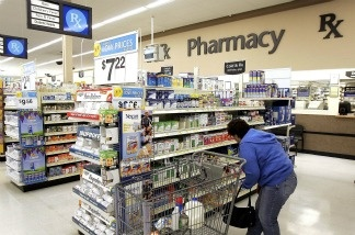 A woman shops in the pharmacy area of a Wal-Mart store.