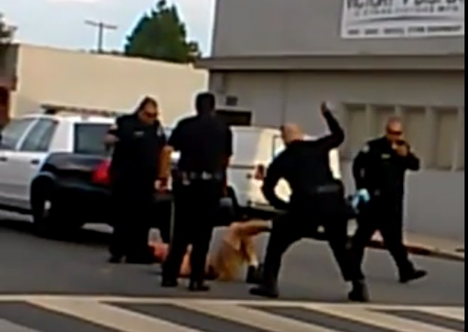 A screencap from a cellphone video posted on YouTube by BeachBoiLBC showing the apparent beating of a man by Long Beach police officers on Monday, Sept. 2, 2013.