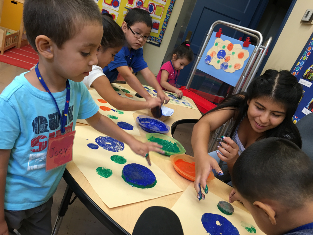Children at Glassell Park Elementary school work on a painting project using sponges. This is one of LAUSD's 169 new ETK classrooms.