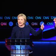 Democratic presidential candidate Senator Bernie Sanders (D-VT) and Democratic presidential candidate Hillary Clinton speak during the CNN Democratic Presidential Primary Debate in Flint, Michigan.