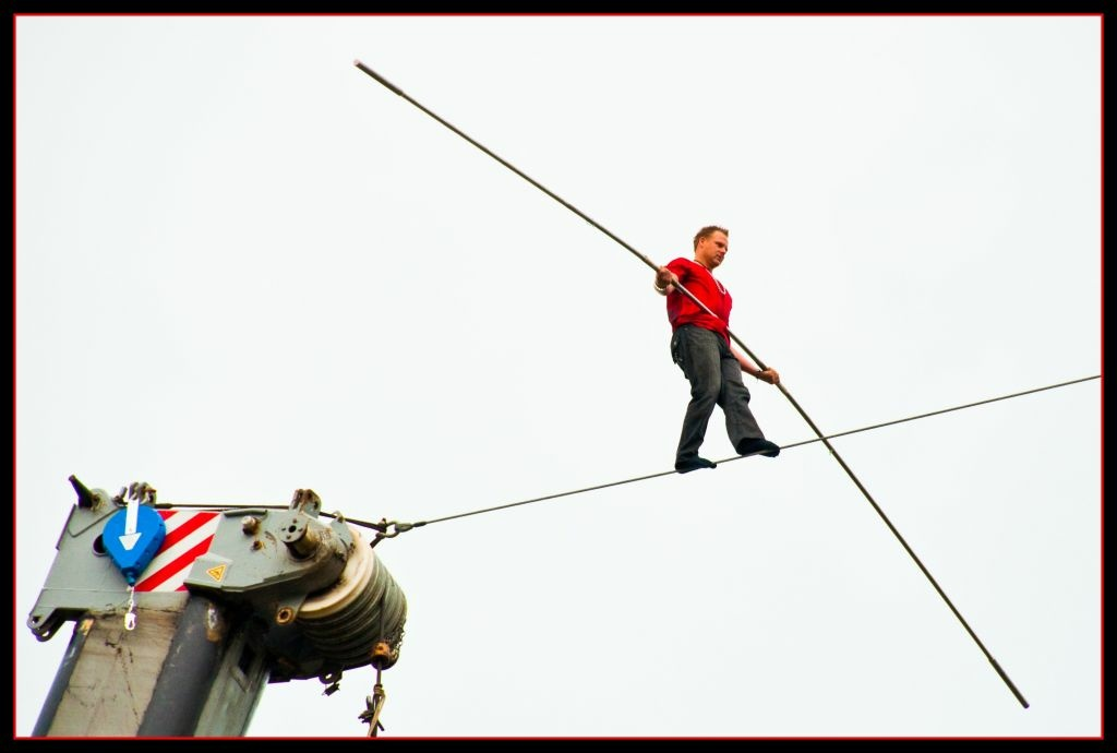 Nik Wallenda, begins his walk across a 1000 ft cable suspended 200 ft above the Allegheny River in Pittsburgh.