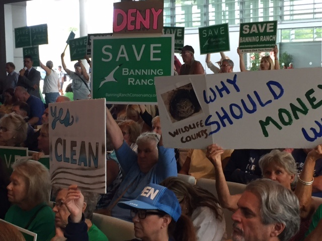 Protesters packed a Coastal Commission meeting, where commissioners voted to reject the controversial Newport Banning Ranch project.