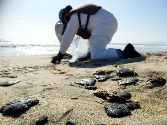 A two-mile stretch of beach was closed in Manhattan Beach May 27, 2015 after balls of what were thought to be oil began washing ashore. Officials said Monday, June 22, 2015 that a sample taken from the beach matched samples from last month's Refugio oil spill near Santa Barbara.