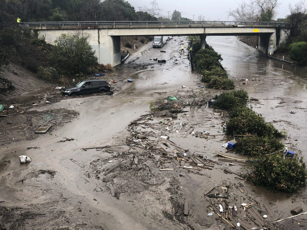 In this photo provided by Santa Barbara County Fire Department, U.S. Highway 101 at the Olive Mill Road overpass is flooded with runoff water from Montecito Creek in Montecito, Calif. on Tuesday, Jan. 9, 2018.