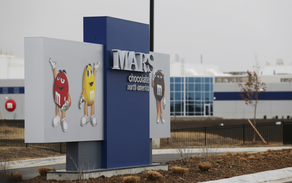 This Wednesday, March 26, 2014, file photo, shows an entrance of a Mars Inc. production facility near Topeka, Kan. Mars is buying the pet health care company VCA in a deal valued at around $7.7 billion.