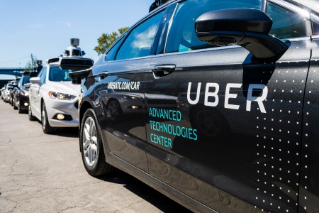 Pilot models of the Uber self-driving car is displayed at the Uber Advanced Technologies Center.