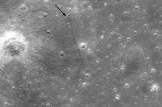 This photo from NASA's Lunar Reconnaissance Orbiter shows the Lunkokhod 2 rover's resting place. The black arrow indicates where the tracks begin — the white arrow and dot shows the rover. Arrows placed by Phil Stooke, geography professor at University of Western Ontario.