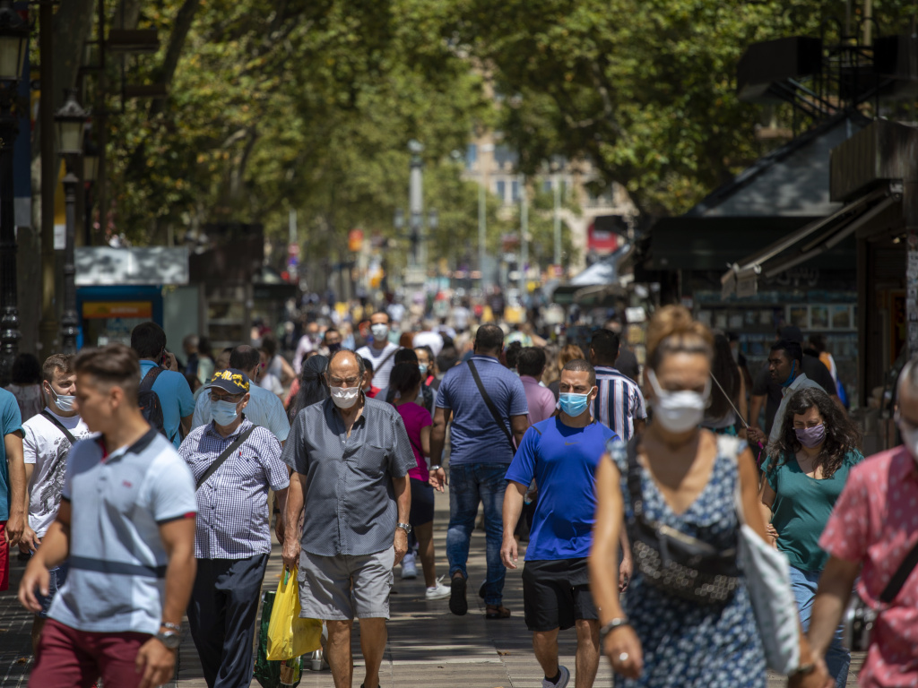 People walk along the Ramblas in Barcelona, Spain, last week. The country has seen cases of the coronavirus spike in recent weeks.