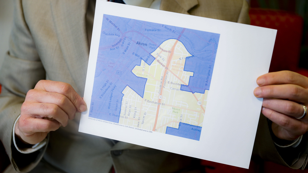 David Niven, a professor of political science at the University of Cincinnati holds a map demonstrating a gerrymandered Ohio district.
