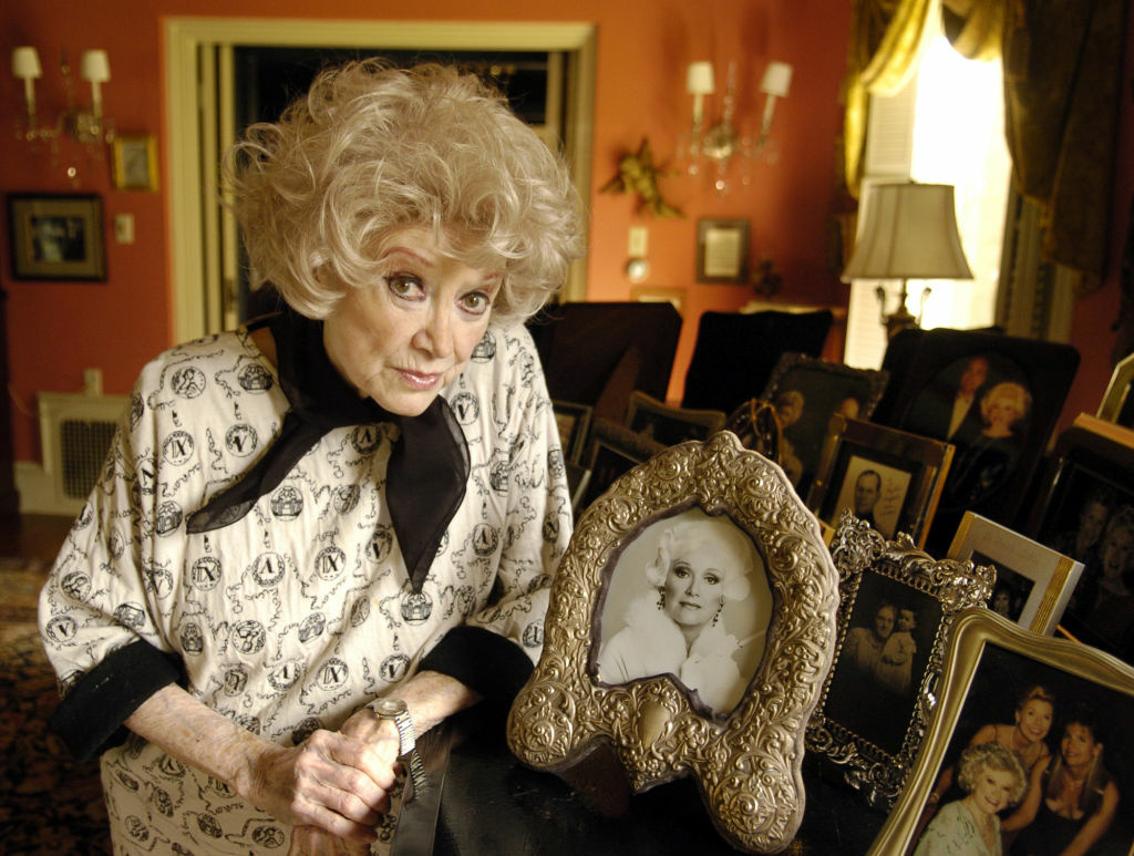 Phyllis Diller poses with her photos at her home in the Brentwood section of Los Angeles