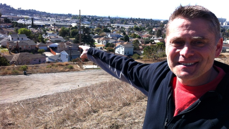 """Where They raced"" director Harry Pallenberg in El Sereno, pointing to the former location of the Legion Ascot racetrack."
