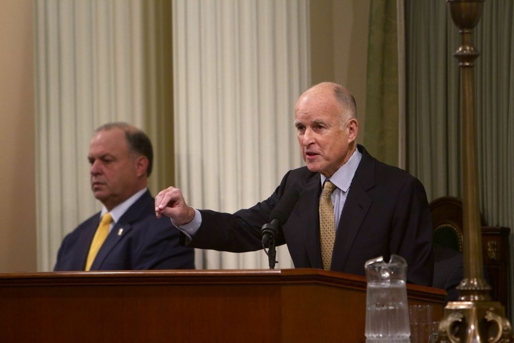California Gov. Jerry Brown delivering his State of the State speech earlier this year. Brown's administration wants to consolidate five state government departments into three by July 1.