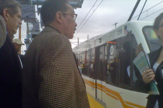 Los Angeles City Councilman Herb Wesson and other elected officials take a peek at the new Metro Expo light rail line. The service is scheduled to start running between downtown L.A. and Culver City starting later this year.