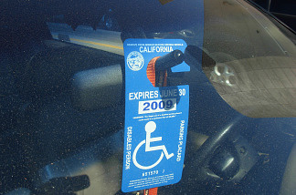 Drivers with valid disabled parking placards may park in accessible spaces where the curb is painted blue.