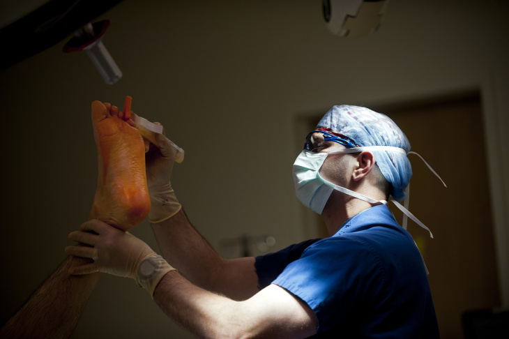 A surgeon scrubs his hands and arms before going into the operating room at Riverside County Regional Medical Center.